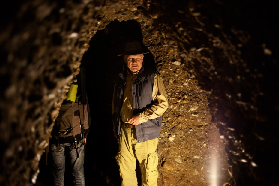 """Mr. Semir Osmanagic, the man who discovered the complex of pyramids in Visoko, is seen inside the Ravne tunnel. Semir is the founder and executive director of the """"Bosnian Pyramids of the Sun Foundation"""" and owner of a metalworking company in the USA. Visoko, Bosnia and Herzegovina, 2014. © Matteo Bastianelli for Discovery Communications"""