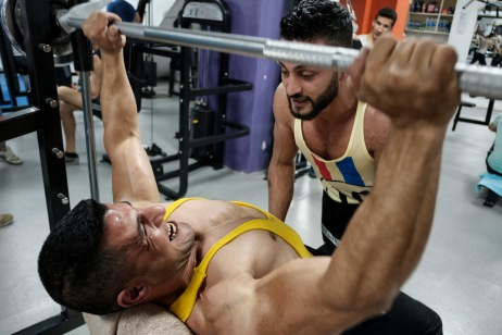 39-year-old award-winning Syrian bodybuilder, Ibrahim Shehabi, trains at the gym. Ibrahim weighed about 100 kg and was at the top of his professional career when he was arrested in Syria on charges of selling medicines without a license at his own gym; a trumped-up accusation, according to Ibrahim. He only weighed about 60 kg at the time of his release on 10 July 2013, after 30 months of imprisonment suffering starvation and torture. Istanbul, Turkey 2016. © Matteo Bastianelli