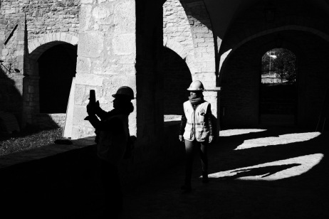 """Francesca Pulcini, the chair of Legambiente Marche, is seen along with a colleague in the courtyard of the former Convent of St. Agostino, now seat of the Civic and Diocesan Museum. Academics and researchers are concerned about the fate of the works of art in the municipalities hit by the earthquake. Visso, Italy 2016. © Matteo Bastianelli for """"La Stampa"""""""