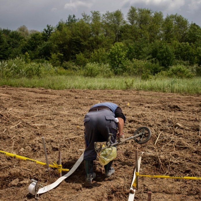 A Norwegian People's Aid deminer is seen working on mine clearance operations in Brčko. Brčko District, Bosnia and Herzegovina, 2014.