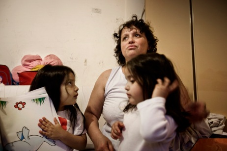 """An Argentinean woman with her two daughters who are some of the occupants at """"Casale de Merode"""". Many people coming from different ethnic backgrounds and nationalities live together in the squat in harmony. Rome, Italy 2009. © Matteo Bastianelli"""