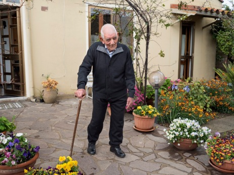 104-year-old Silvio Cadoni is seen in his courtyard. Silvio is one of the 360 Sardinian centenarians, one of the places where people live longer than anywhere else on earth. Samassi, Italy 2015. © Matteo Bastianelli