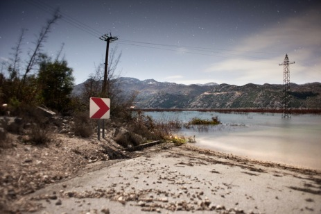 "Country roads and crops completely flooded. Pylons stand in the middle of the ""new lake"" born just 20 days ago. Ravno, Bosnia and Herzegovina 2010. © Matteo Bastianelli"