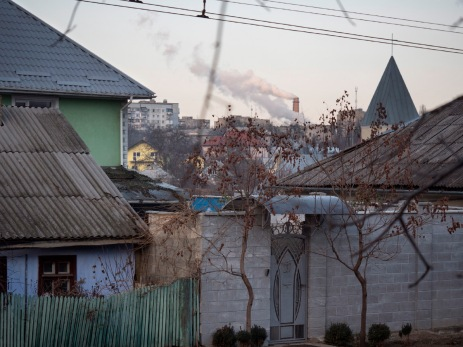 """A view of the outskirts of the """"de facto"""" capital of the autonomous region of Transnistria, in the background we can see the smoke from a factory chimney-stack. Tiraspol, Transnistria (Moldova) 2014. © Matteo Bastianelli"""