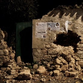 Some death notices on the remains of a building badly damaged by a 5.9 magnitude earthquake. Visso, Italy 2016. © Matteo Bastianelli