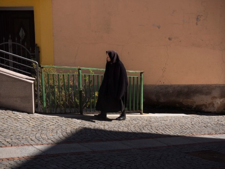 An old woman walking through the streets of Villagrande. The village is the world-record holder for male longevity. Villagrande Strisaili, Italy 2015. © Matteo Bastianelli