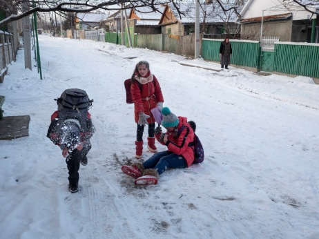 """Some students during a snowball fight on their way home from the """"Mihai Eminescu"""" high school; the only school to teach in the Moldavian language situated in Gagauzia, a region with a Turkish-Russian majority. Comrat, Moldova 2014. © Matteo Bastianelli"""