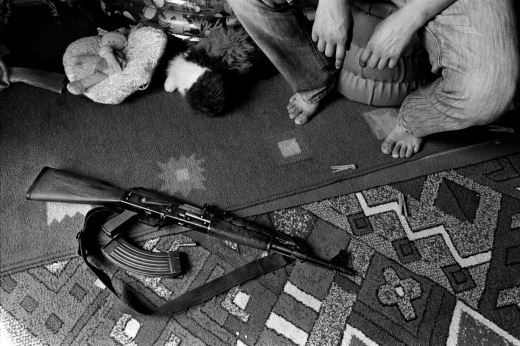 A man with an Ak 47 in his daughter's room. A lot of families still have guns and military equipment in their homes, because they fear for the possibility of another outbreak of war here in The Balkans. Cerska, Serb Republic of Bosnia and Herzegovina 2009. © Matteo Bastianelli