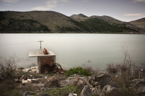 Country roads and crops completely flooded. A pylon stands in the middle of the new lake. Popovo Polje, Bosnia and Herzegovina 2010. © Matteo Bastianelli