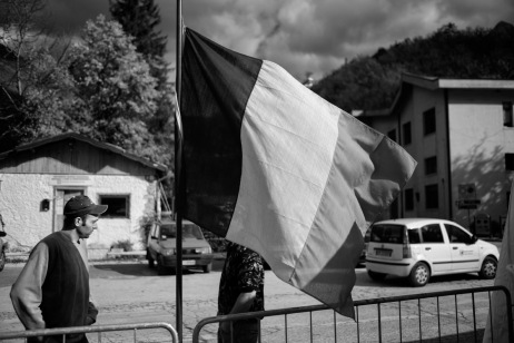 """Two young men are seen next to an Italian flag. Ussita, Italy 2016. © Matteo Bastianelli for """"La Stampa"""""""