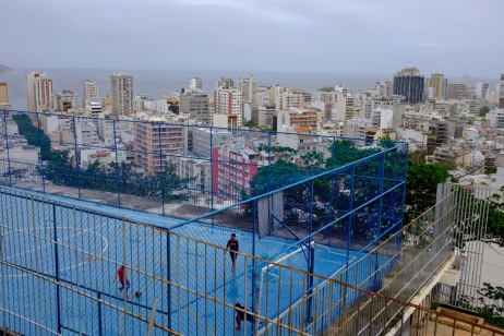 Some guys play on a football pitch in the favela of Cantagalo. Rio de Janeiro, Brazil 2015. © Matteo Bastianelli
