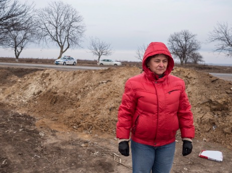 Vera Semionov, owner of a plot of land and administer of other peoples'plots, annot cultivate the plot of land beyond the road, even though she owns it, because it's on the Transnistria side. Police control day and night and the Russians even raised a barricade to prevent her from passing the border between Moldova and Transnistria through this stretch of dirt road. Doroţcaia, Moldova 2014. © Matteo Bastianelli