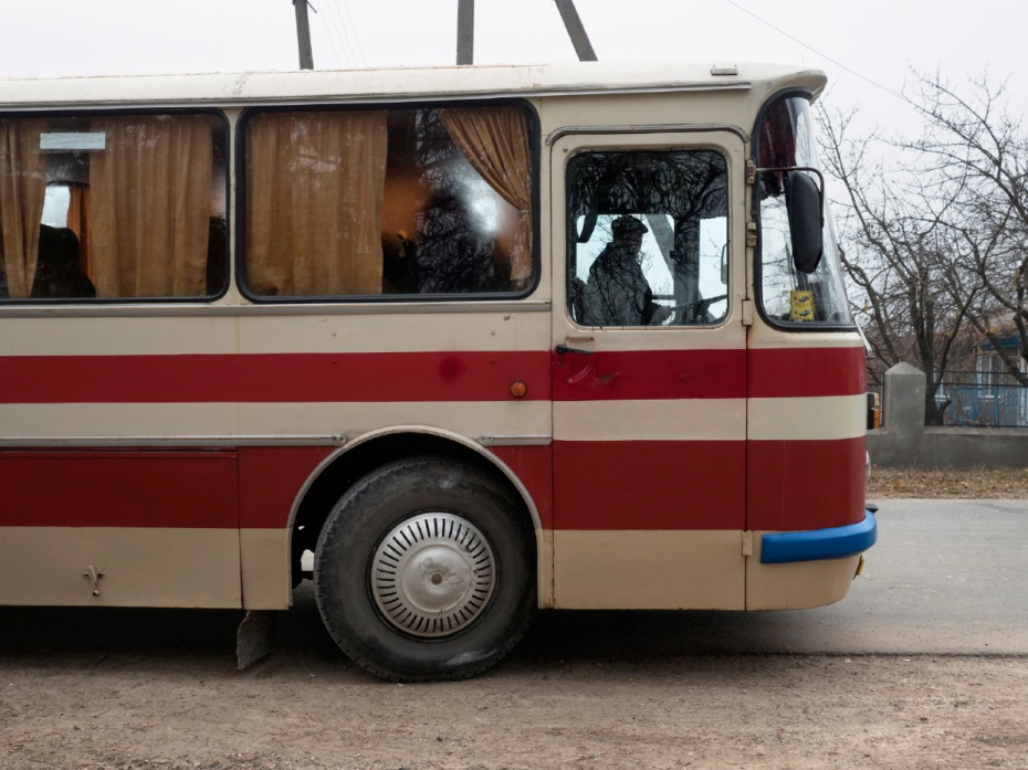 A bus in front of a school in Doroţcaia. About 200 students cross the border daily to study in their native language, not allowed in Transnistria, where they are obliged to study the Russian language with Cyrillic characters. Doroţcaia, Moldova 2014. © Matteo Bastianelli