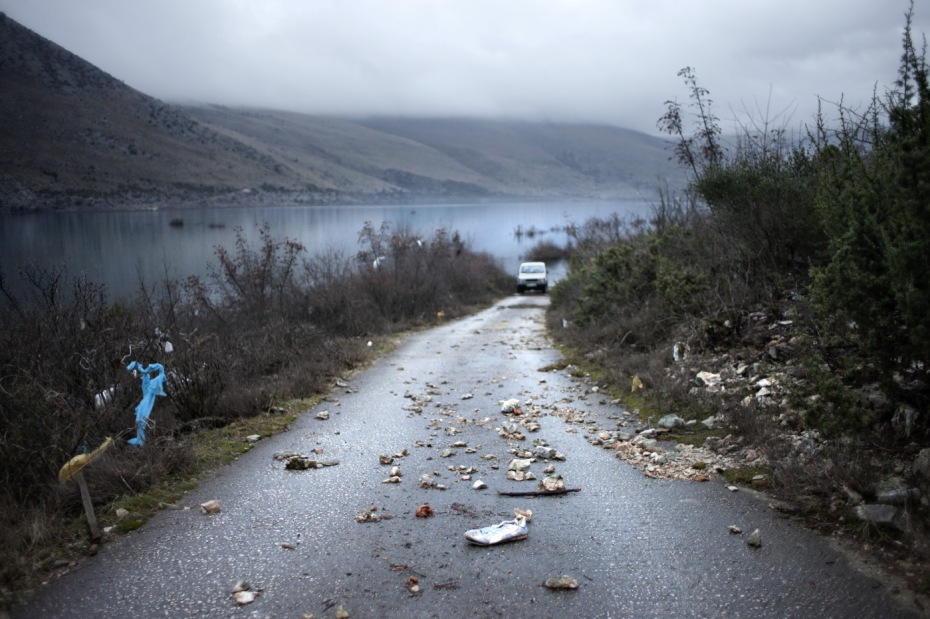 Twenty days after the overflow, the water level goes down about 4 meters. The road starts to reappear. Popovo Polje, Bosnia and Herzegovina 2010. © Matteo Bastianelli