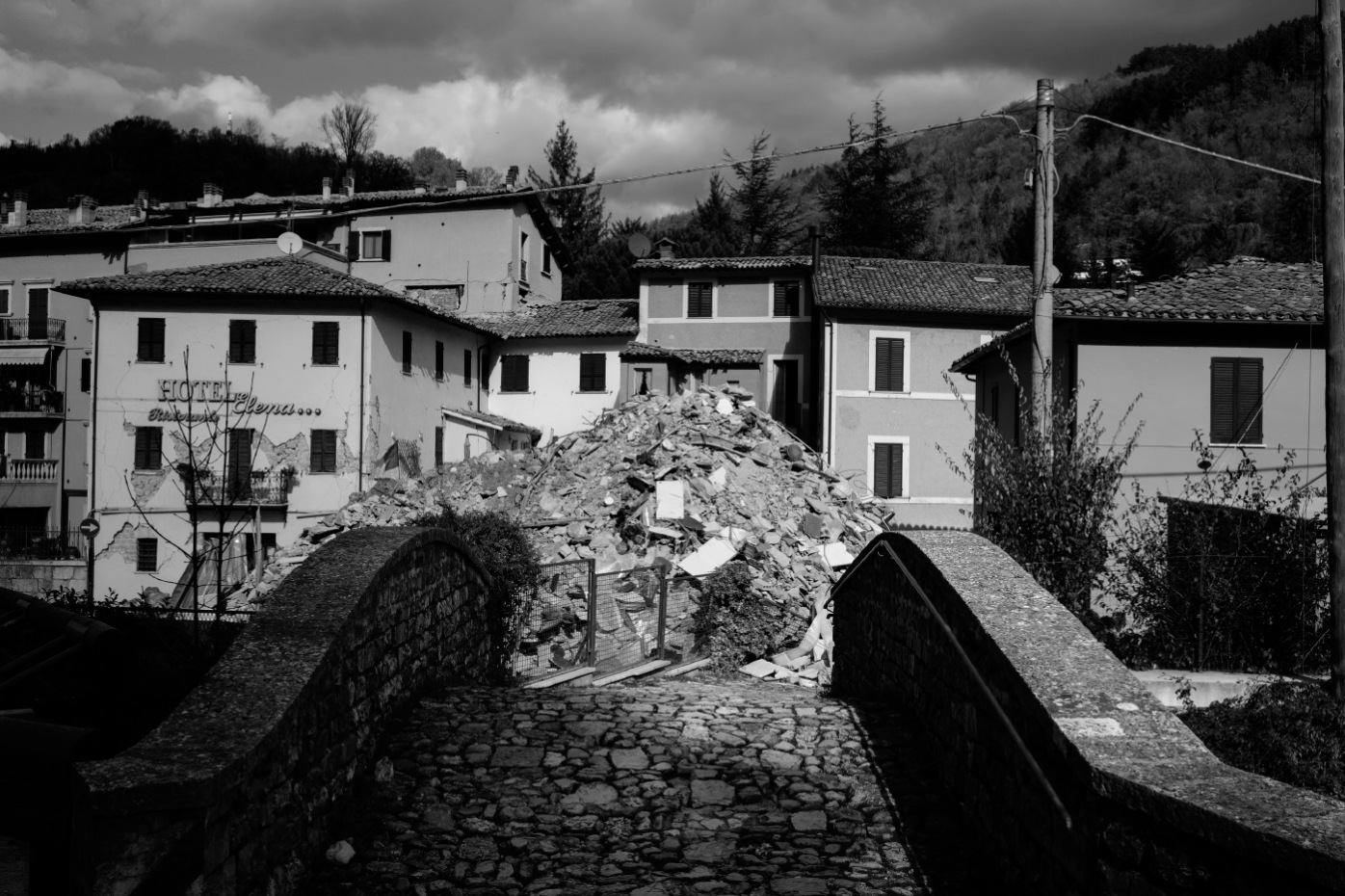"""The ruins of a building in front of others left standing. Visso, Italy 2016. © Matteo Bastianelli for """"La Stampa"""""""