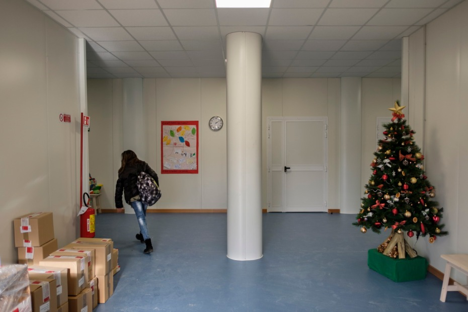 """A girl is seen inside the 2.0 Youth Center, where children and parents are engaged together in educational, recreational and cultural activities. Amatrice, Italy 2016. © Matteo Bastianelli for """"La Stampa"""""""