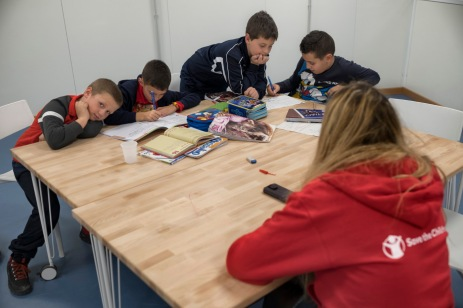 """Some kids are seen doing their homework followed by a teacher from Save the Children, at the 2.0 Youth Center. Amatrice, Italy 2016. © Matteo Bastianelli for """"La Stampa"""""""