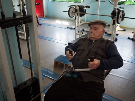 96-year-old Michelino Scudu while working out at the gym. Michelino survived the Second World War after 5 years of fighting between France, ex-Yugoslavia and Germany. Villagrande Strisaili, Italy 2015. © Matteo Bastianelli