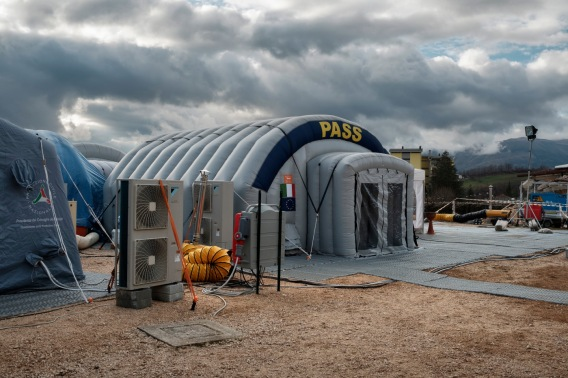 """A Civil Protection social and health station (PASS) set up inside a tent at the Lazio Camp. Amatrice, Italy 2016. © Matteo Bastianelli for """"La Stampa"""""""