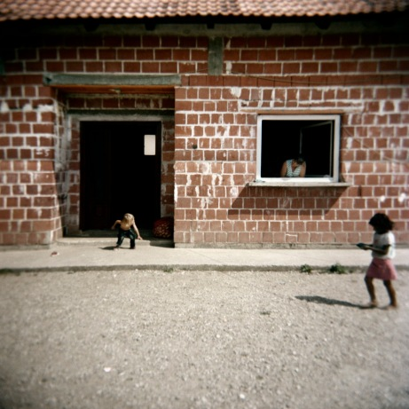 Some children play in front of their house. Most Rom children are not included in the Croatian Education System and only a very few get a chance of going on to secondary school and university. Podturen (Međimurje), Croatia 2009. © Matteo Bastianelli