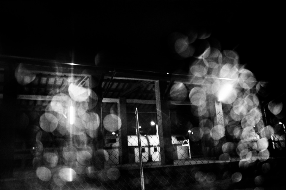 A train stopped on the tracks at the station of Velletri in a rainy night. Velletri, Italy 2009. © Matteo Bastianelli