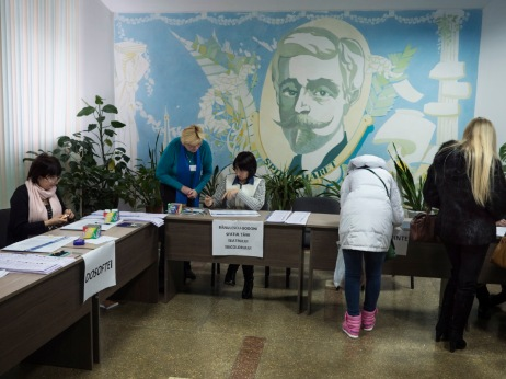 One of the polling stations for the parliamentary elections, in the background a reproduction painting of the Romanian-Armenian mathematician, astronomer and politician Spiru Haret. Chisinau, Moldova 2014. © Matteo Bastianelli