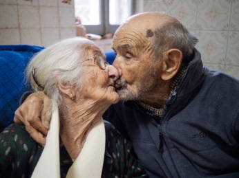 101-year-old Vittorio Palmas with his 95-year-old wife Giuseppa. They have been married for 69 years and they kiss each other every day. Perdasdefogu, Italy 2015. © Matteo Bastianelli