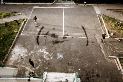 A view from above of the communal areas of a squat, founded 6 years ago in the outskirts of Rome, Italy 2009. © Matteo Bastianelli