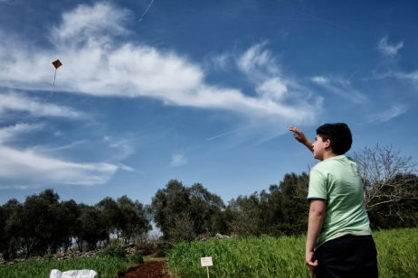 A child is flying a kite on the land where an association has been allowed to cultivate vegetables and to sow hemp for free. Castiglione d'Otranto, Italy 2016. © Matteo Bastianelli