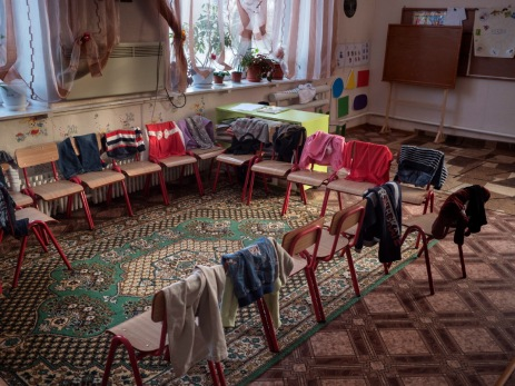 Some children's clothes while the youngsters are having a rest during a break from lessons. Comrat, Moldavia 2014. © Matteo Bastianelli