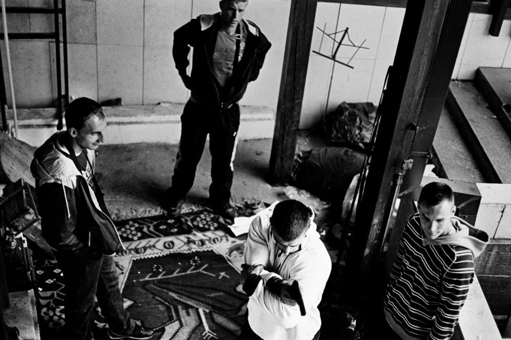 "Tarik pretends to shoot one of his ""rivals"", while Nihad, Buqva and Djenan look on. Sarajevo, Bosnia and Herzegovina, 2010. © Matteo Bastianelli"
