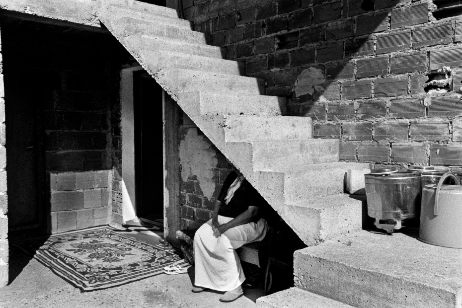 A woman in the courtyard where she lives. Cerska, Serb Republic of Bosnia and Herzegovina, 2009. © Matteo Bastianelli
