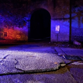 The flashing lights of emergency vehicles brighten the entrance to the historic centre. The road, badly damaged by the earthquake, has been closed to the traffic. Norcia, Italy 2016. © Matteo Bastianelli