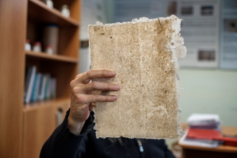 Franco Casalone, expert hemp-grower, examines a sheet of paper obtained by processing hemp fibers. Carmagnola, Italy 2017. © Matteo Bastianelli
