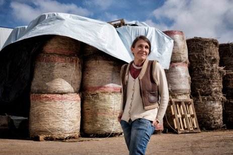 The entrepreneur Rachele Invernizzi is seen in front of hemp straw bales piled up at her facility, the first hemp processing center in southern Italy. Crispiano, Italy 2016. © Matteo Bastianelli