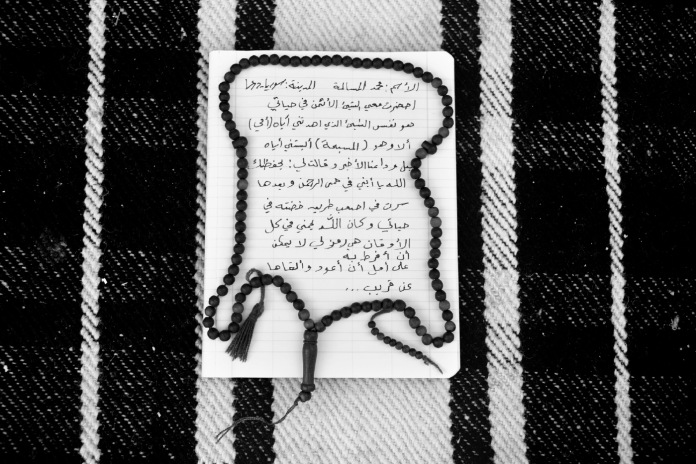 """Text written by 21-year-old Syrian refugee Mohamad Al Masalmeh, in which he explains what he decided to bring with him before fleeing his country. """"I brought with me the most important thing in my life, it's a necklace my mother gave to me before I left while telling me: «God have mercy on you»"""". Harmanli, Bulgaria 2014. © Matteo Bastianelli"""