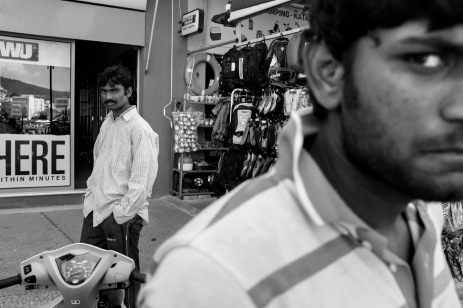 Two Pakistani refugees are seen outside a shop in the city center of Mytilene, Lesbos, Greece 2015. © Matteo Bastianelli