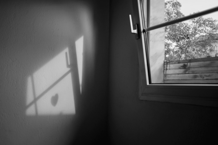 A view from inside of Hotel Astro, used by migrants as a staging point before resuming their journey to the border town of Evzoni, near FYROM. Polykastro, Kilkis, Grecia 2015. © Matteo Bastianelli