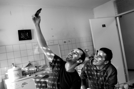 Syrian asylum seekers Mohamad and Hany Al Masalmeh take a selfportrait of them in the room where they are living inside a facility for refugee. Warstein, Germany 2014. © Matteo Bastianelli