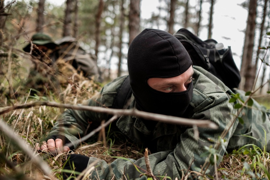 """Two volunteers from the """"Vasil Levski"""" Bulgarian Military Veterans Union are seen during a drill in the forest near the Nestinarka camping. Tsarevo, Bulgaria 2017. © Matteo Bastianelli"""