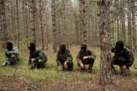 """Some volunteers from the """"Vasil Levski"""" Bulgarian Military Veterans Union and from the """"BNO Shipka"""" are seen during a drill in the forest near the Nestinarka camp-site. Four to five times a month, they train like an army to face what they consider an invasion to """"Islamize"""" Europe. Tsarevo, Bulgaria 2017. © Matteo Bastianelli"""