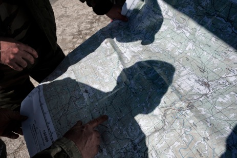 """60-year-old Vladimir Rusev, a retired military officer and Chief Commander of the """"Vasil Levski"""" Bulgarian Military Veterans Union, looks at a map with a fellow soldier to determine the place where they will patrol the Bulgarian-Turkish border, along with the other volunteers of the movement. Primorsko, Bulgaria 2017. © Matteo Bastianelli"""