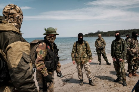 """Some volunteers from the """"Vasil Levski"""" Bulgarian Military Veterans Union are seen on a beach in the vicinity of the Nestinarka camp-site on the Black Sea coast. Their movement has more than 800 members divided in groups of 30-40 people who take turns patrolling the Bulgarian-Turkish border to prevent illegal crossings through the forest. They wear ski masks to protect their identity; ISIS has put out a reward for some of them. Tsarevo, Bulgaria 2017. © Matteo Bastianelli"""