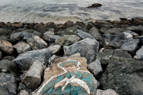 A mural depicting a Bulgarian military man on the rock breakwater of the Black Sea coast, in the town of Primorsko, Burgas province, Bulgaria 2017. © Matteo Bastianelli