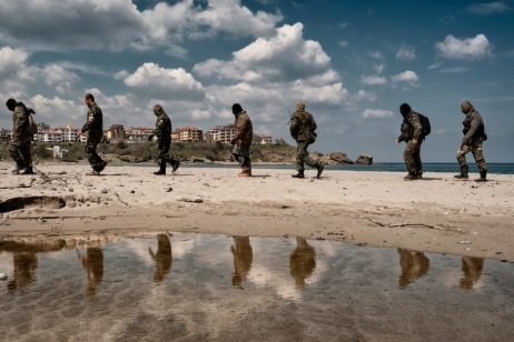 """Some volunteers from the """"Vasil Levski"""" Bulgarian Military Veterans Union and from the """"BNO Shipka"""" are seen training on a beach in the vicinity of the Nestinarka camp-site on the Black Sea coast. They don't want to be called migrant-hunters: they consider themselves the defenders of the European southern border. Tsarevo, Bulgaria 2017. © Matteo Bastianelli"""