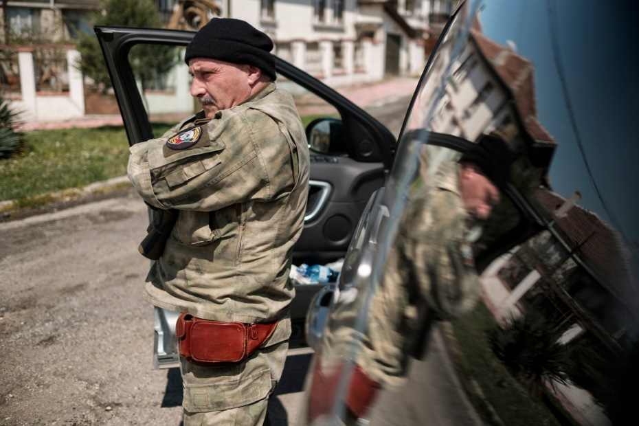 """60-year-old Vladimir Rusev, a retired military officer and Chief Commander of the """"Vasil Levski"""" Bulgarian Military Veterans Union, is seen awaiting the arrival of the other members of the movement. Primorsko, Bulgaria 2017. © Matteo Bastianelli"""