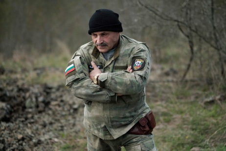 """60-year-old Vladimir Rusev, a retired military officer and Chief Commander of the """"Vasil Levski"""" Bulgarian Military Veterans Union, is seen in a forest at the Bulgarian-Turkish border. Yasna Polyana, Bulgaria 2017. © Matteo Bastianelli"""