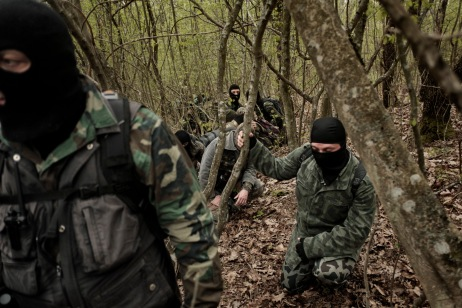 """Some volunteers from the """"Vasil Levski"""" Bulgarian Military Veterans Union and from the """"BNO Shipka"""" are seen patrolling a forest, about 30 kilometers from the border with Turkey. They wear ski masks to protect their identity; ISIS has put out a reward for some of them. Yasna Polyana, Bulgaria 2017. © Matteo Bastianelli"""