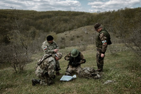 """60-year-old Vladimir Rusev, a retired military officer and Chief Commander of the """"Vasil Levski"""" Bulgarian Military Veterans Union, looks at a map with other volunteers to determine the place where they will patrol the Bulgarian-Turkish border. Yasna Polyana, Bulgaria 2017. © Matteo Bastianelli"""