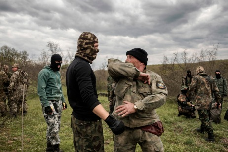 """60-year-old Vladimir Rusev, a retired military officer and Chief Commander of the """"Vasil Levski"""" Bulgarian Military Veterans Union, shows the volunteers how to fight in hand-to-hand combat. They don't want to be called migrant-hunters, but they train following military techniques in order to face a possible invasion. Yasna Polyana, Bulgaria 2017. © Matteo Bastianelli"""